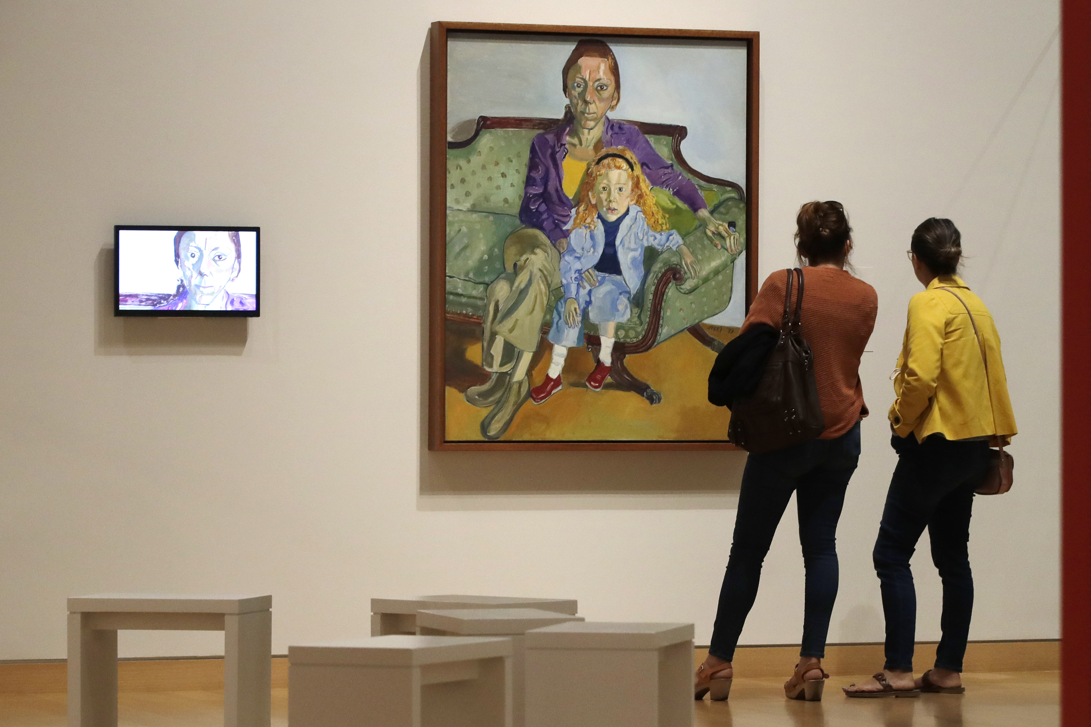 """In this Sept. 18, 2019, photo, two women look at a painting by American artist Alice Neel at the exhibit """"Women Take the Floor"""" at the Museum of Fine Arts in Boston. In the wake of a student group incident last spring when the world-class museum was accused of racism, the MFA has scrambled to make amends. In a nod to the need for greater gender equity, it has given over an entire wing to female artists in """"Women Take the Floor,"""" an exhibition timed to coincide with next year's centennial of U.S. women winning the right to vote. (AP Photo/Elise Amendola)"""