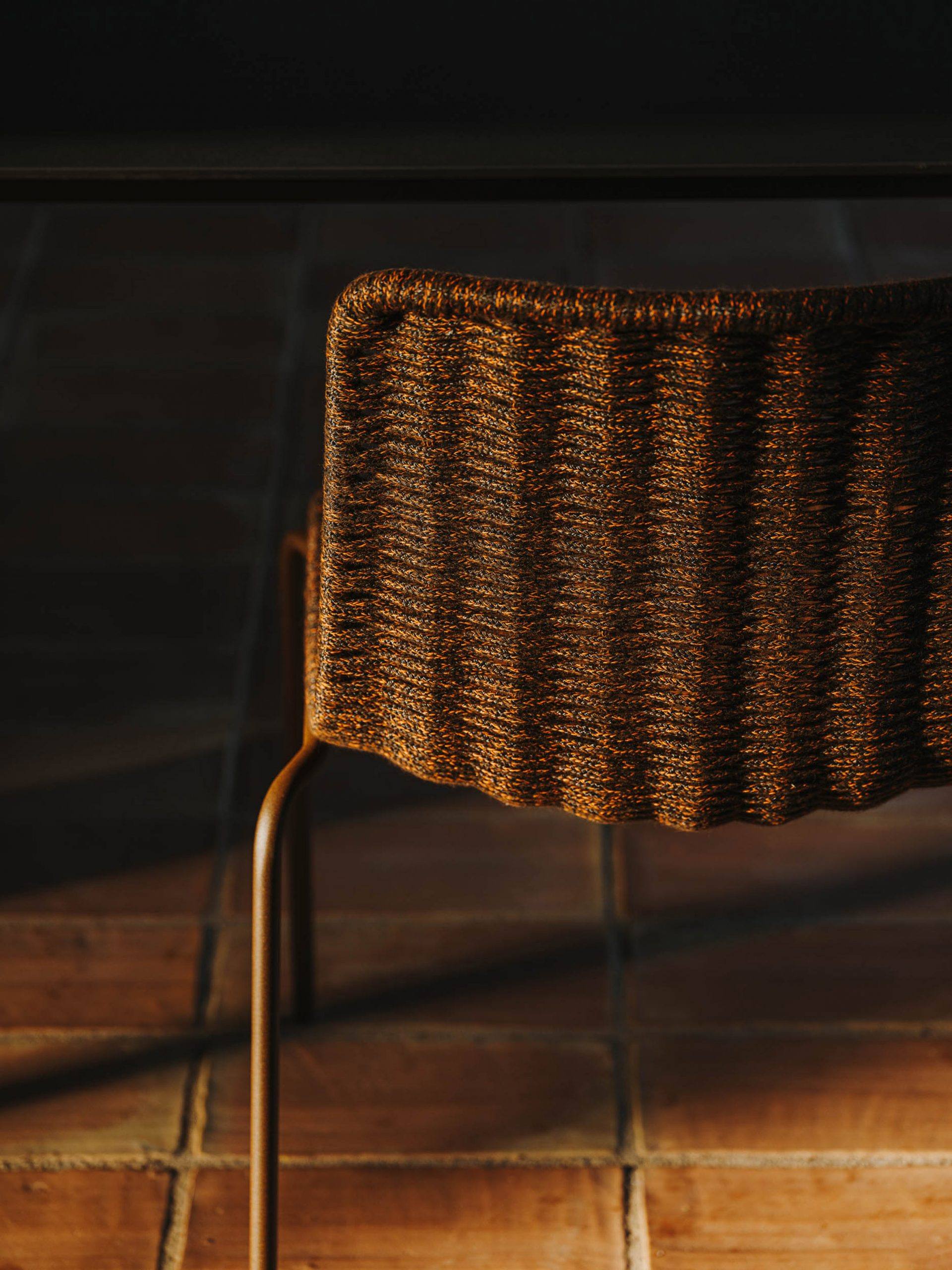 The seat and backrest are handwoven with a tightly braided weather-resistant nautical rope