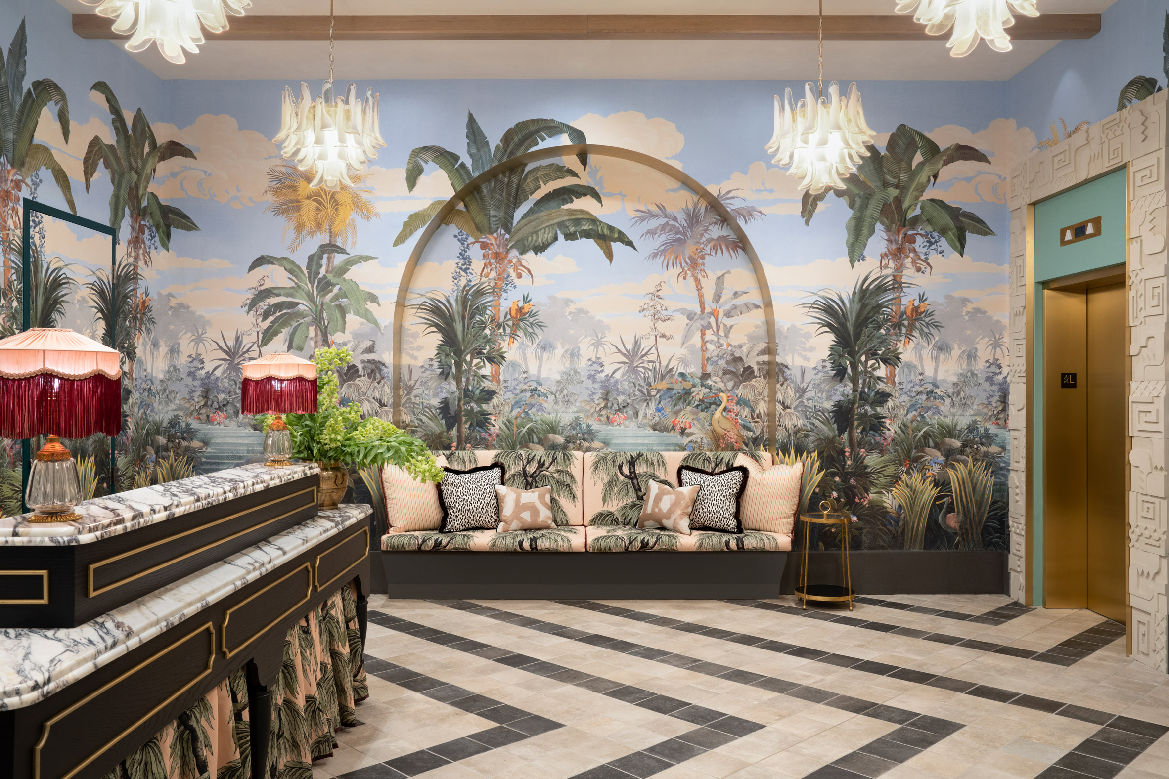 Lobby of the Goodtime Hotel with tropical mural and patterned tiles
