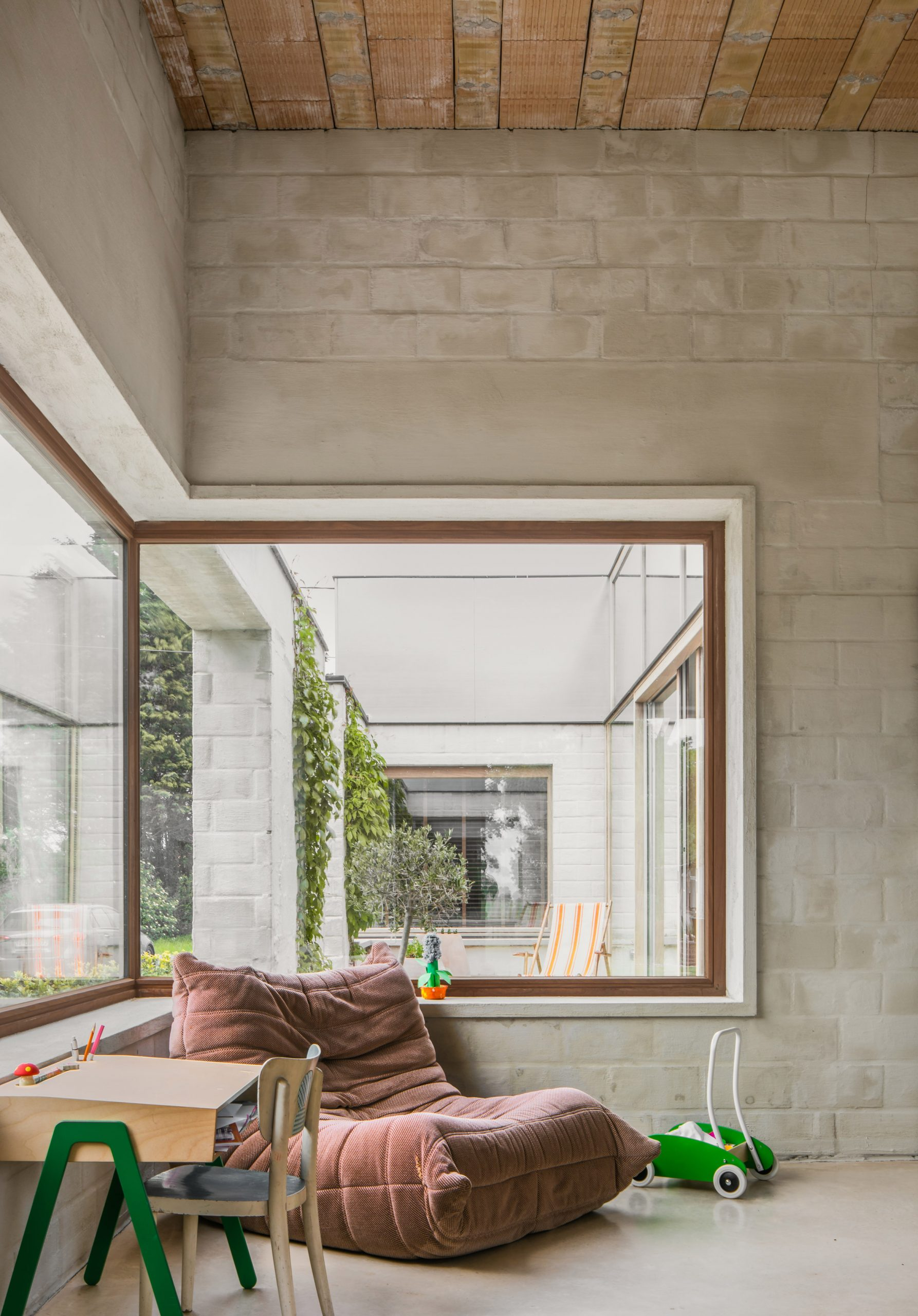 A living room with a corner window