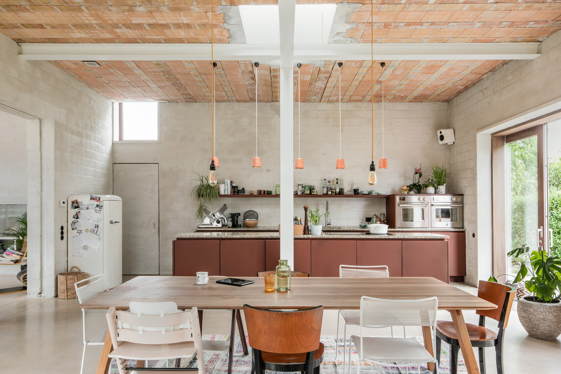 A large kitchen with exposed steel beams