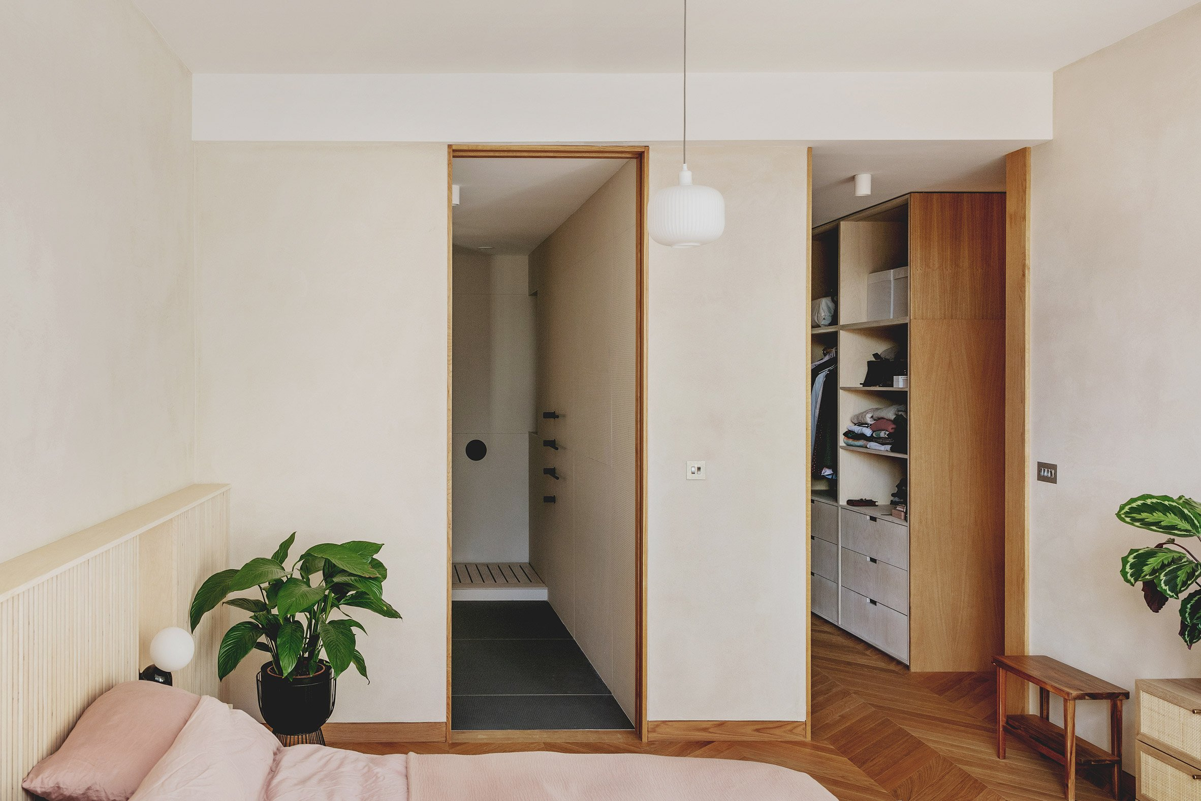 Main bedroom with en-suite and walk-in-wardrobe in St John Street warehouse apartment by Emil Eve Architects