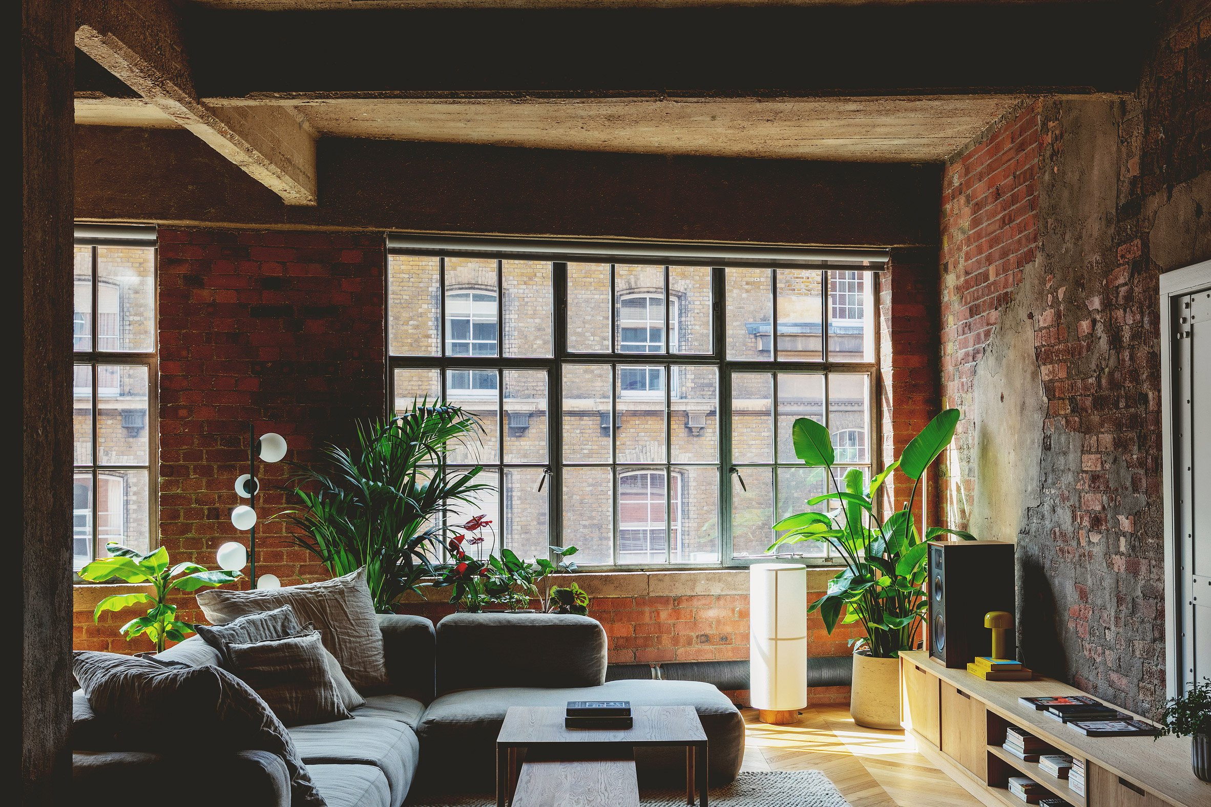 Lounge windows in St John Street warehouse apartment by Emil Eve Architects